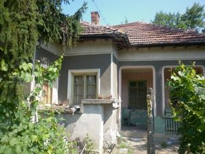 An old rural house with nice plot of land located near the center of a big village near forest and river