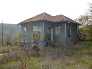 An old rural house located in a quiet village near forest