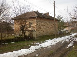 An old rural house with garage,barn and plot of land