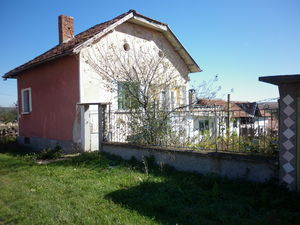 Old rural house with garage,barn and plot of land in village
