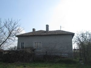 Old country house with plot of land in village near the sea