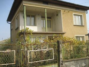 Solid house with nice yard located in village near main road