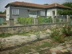 Solid country house with big garden in a village near lake