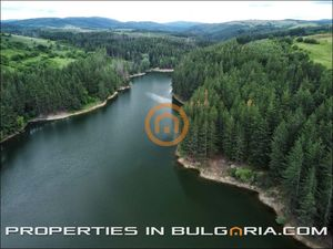 Large plot of building on the bank of beautiful mountain lak