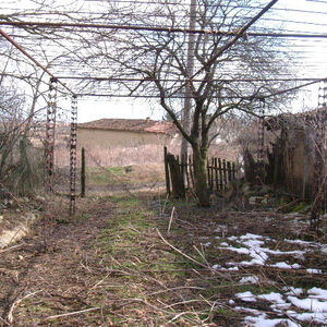 An old house with plot of land located 85 km from the sea