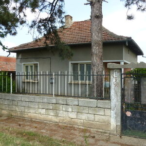 Two houses with garage, storage building and plot of land