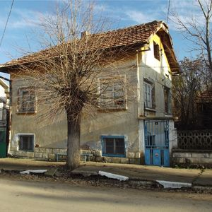 Old rural house with land located near the center of village