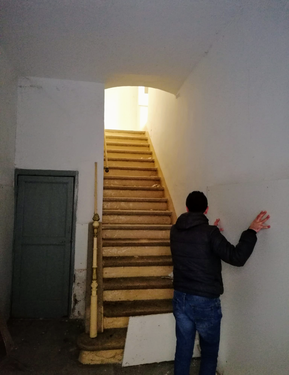MAIN HALLWAY WITH STAIRS